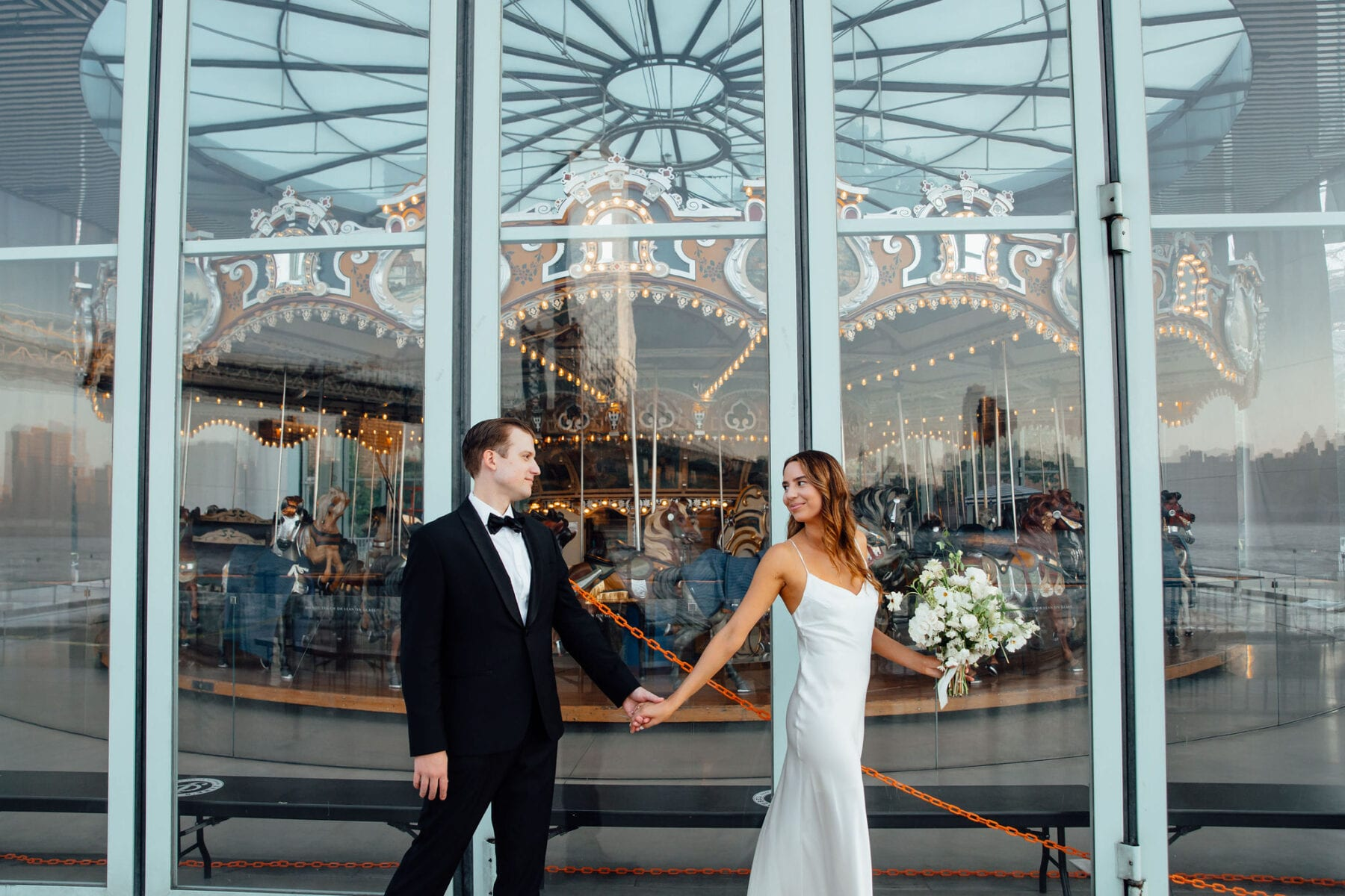 Bride and groom at Jane Carousel